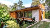 Ấn tượng với vẻ đẹp thơ mộng của ngôi nhà gỗ giữa rừng xanh